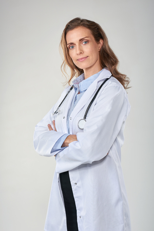 labcoat: Portrait of trusted woman doctor isolated on grey background, labcoat and stethoscope
