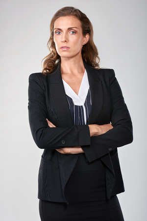 Portrait of middle age woman in middle upper management, serious professional executive 스톡 콘텐츠