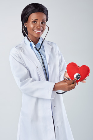 encouraging: Female doctor holding a red heart encouraging a healthy lifestyle