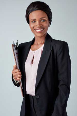 african business: Beautiful black african corporate business woman confident with clipboard