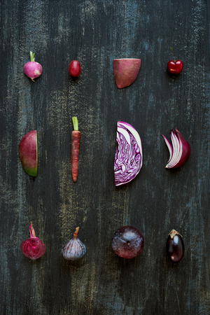 produce sections: Gradient of purple colour tone fruit and vegetables from light to dark, artistic food poster of fresh produce
