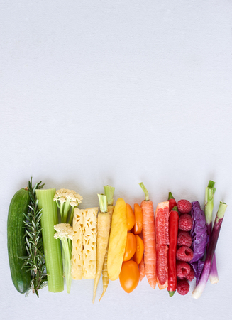 produces: Rainbow spectrum gradient of healthy fresh fruit and vegetables,  colourful food background