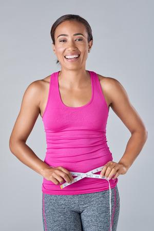 waistline: Slim sporty woman measuring waistline, healthy living wellness weight loss concept Stock Photo