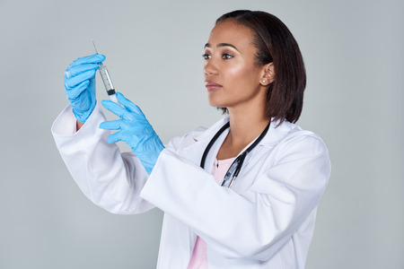 medical cure: Medical professional scientist researcher holding a syringe injection jab  vaccination cure discovery