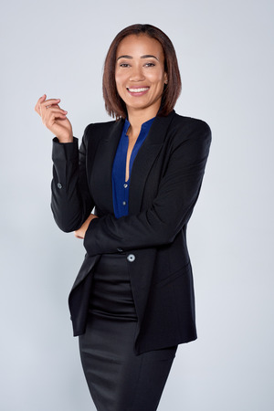 Smiling mixed race hispanic business woman portrait in studio