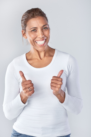 thumbs up woman: Portrait of asian woman with two thumbs up, happy approval