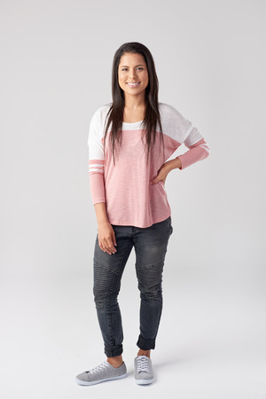 casual attire: Full length portrait of pretty young woman in casual attire, isolated on grey in studio