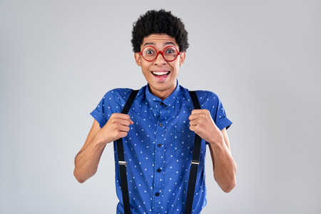 Funny mixed race man comedian portrait with excited shocked face