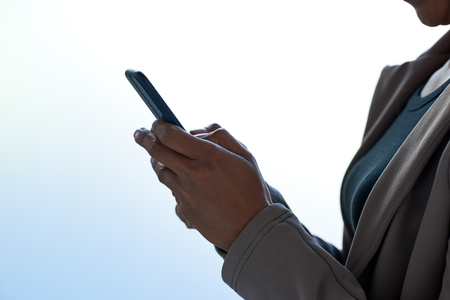 Modern business woman  using a smartphone using apps application accessing online content Stock Photo