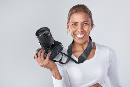 Confident woman holding dslr camera, professional photographer