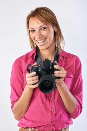 confident: Confident real woman holding dslr camera, professional photographer