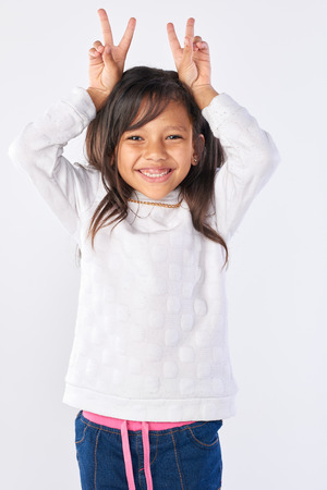 cute adorable girl playful fun portrait in studio isolated