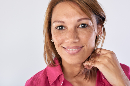 hispanic woman: Real woman portrait in studio, happy laughing face