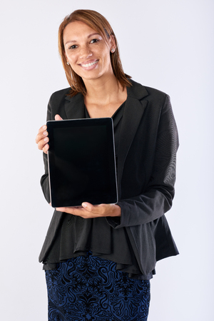 accessing: Modern business woman  using a tablet computer using apps application accessing online content