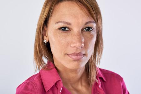 hispanic woman: Real woman portrait in studio, serious face