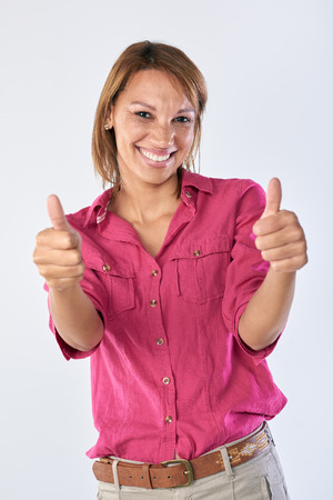 two thumbs up: Portrait of asian woman with two thumbs up, happy approval