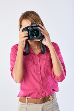 asian lady: Confident real woman holding dslr camera, professional photographer