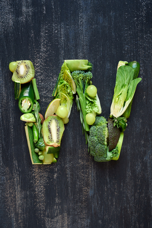 savoy cabbage: Flat lay series of healthy green produce fruit and vegetables shaped into letters of alphabet, design element poster spelling layout Stock Photo