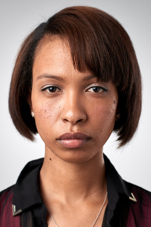 Portrait of real black african woman with no expression ID or passport photo full collection of diverse face and expressions Standard-Bild
