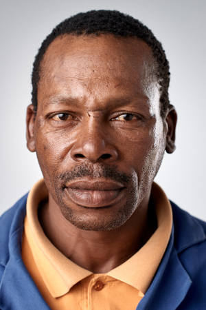 Portrait of real black african man with no expression ID or passport photo full collection of diverse face and expressions