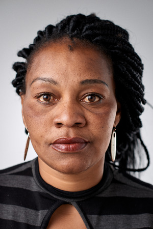 foto carnet: Portrait of real black african woman with no expression ID or passport photo full collection of diverse face and expressions Foto de archivo