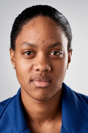 women face stare: Portrait of real black african woman with no expression ID or passport photo full collection of diverse face and expressions Stock Photo