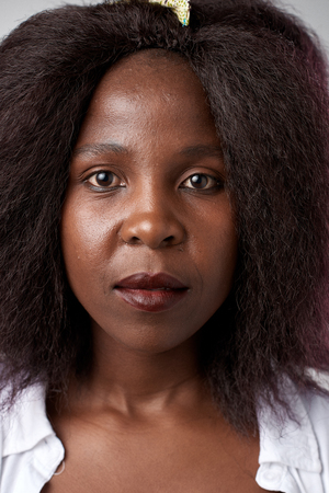 stares: Portrait of real black african woman with no expression ID or passport photo full collection of diverse face and expressions Stock Photo