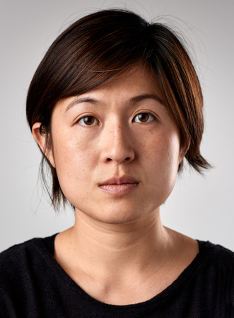 Portrait of real chinese asian woman with no expression ID or passport photo full collection of diverse face and expressions Stockfoto