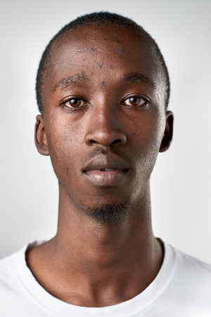 foto carnet: Portrait of real black african man with no expression ID or passport photo full collection of diverse face and expressions