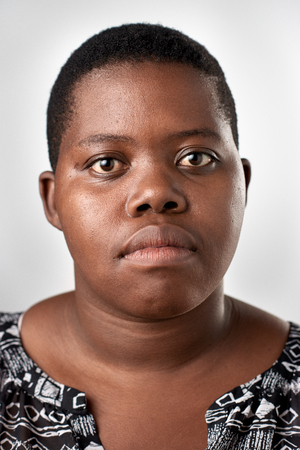 Portrait of real black african woman with no expression ID or passport photo full collection of diverse face and expressions Stock Photo