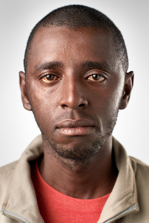 expressionless: Portrait of real black african man with no expression ID or passport photo full collection of diverse face and expressions