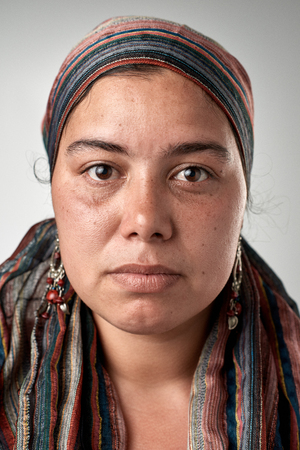 gypsy woman: Portrait of real gypsy woman with no expression ID or passport photo full collection of diverse face and expressions