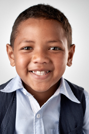 child boy: Portrait of real happy mixed race child smiling