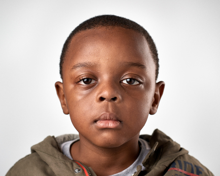 expressionless: portrait of young african black boy