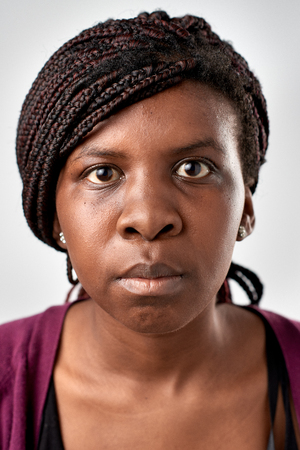 expressionless: Portrait of real black african woman with no expression ID or passport photo full collection of diverse face and expressions Stock Photo