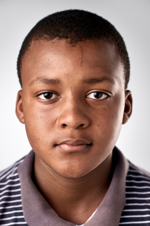 profile face: portrait of young african black boy