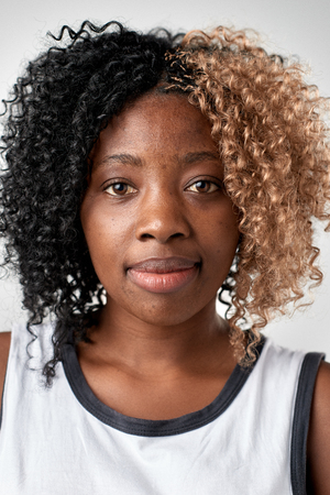 Portrait of real black african woman with no expression ID or passport photo full collection of diverse face and expressions Stockfoto