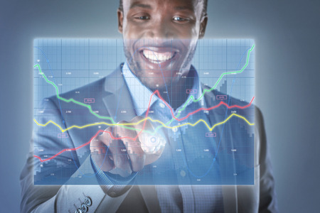 platforms: Happy business man looking at hologram showing financial graphs and stocks information analysing business information and data