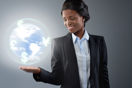 african business: Black african business woman with 3D earth hologram, global currency trading business concept Stock Photo