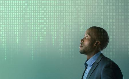 decryption: African business man with hologram binary code Algorithm binary, data code, decryption, encoding, row matrix Stock Photo