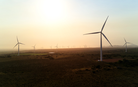 Harnessing wind power at energy production generating farm, clean renewable resource