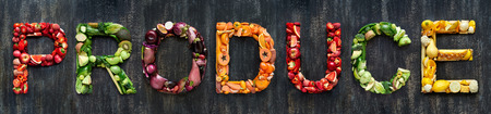 Flat lay collection of food words formed by fresh produce fruits and vegetables raw harvest
