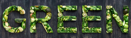 green spelled with different hues of fresh produce fruits and vegetables Stock Photo
