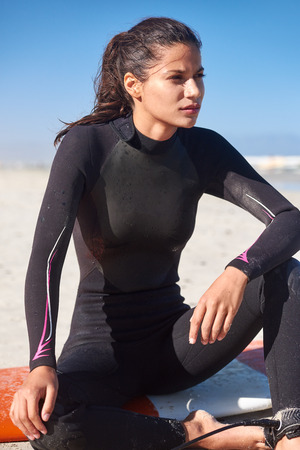 Woman surfer concentrating looking out to waves, serious portrait Stock Photo - 80794587