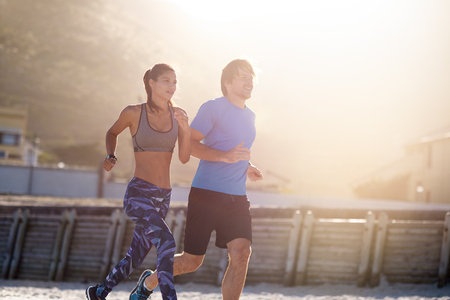 Fitness couple friends exercising together, cardio exercise active healthy lifestyle, golden sun flare