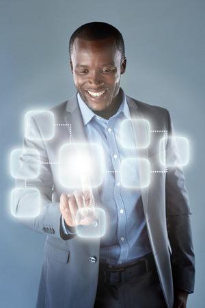 African businessman in suit using futuristic hologram virtual interface display innovative modern technology Stok Fotoğraf