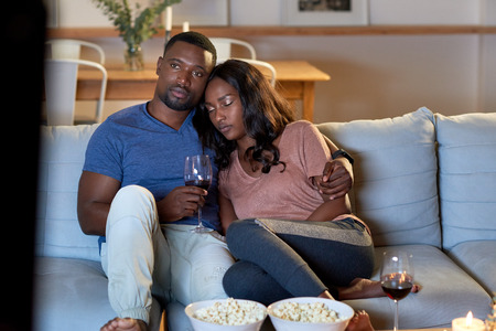 Black african couple watching movie television together having date night Reklamní fotografie