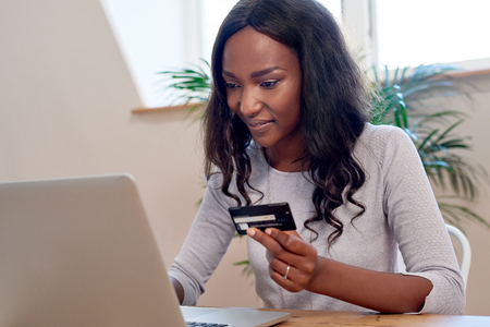 Woman using credit card to purchase items online modern banking Reklamní fotografie