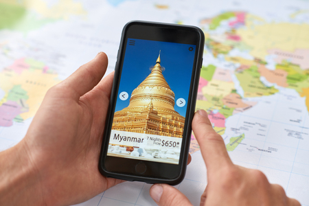 hands using smartphone with travel holiday destination deals on mobile app application, planning vacation Stok Fotoğraf