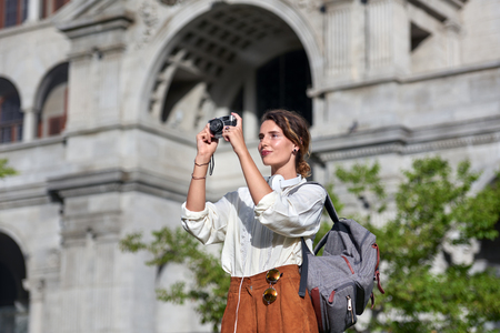 Woman taking pictures while traveling on vacation 版權商用圖片